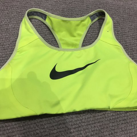 9adca22dc9905 Nike neon yellow sports bra-size XS. Love this but only it s - Depop