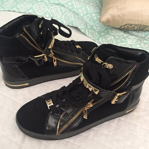 bb828fd6468a9 michael kors gold sneakers!! - black and gold high top - - - Depop