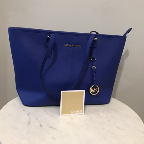 b1d8f5f27fa713 Michael Kors Jet set travel top zip tote bag in royal blue - Depop