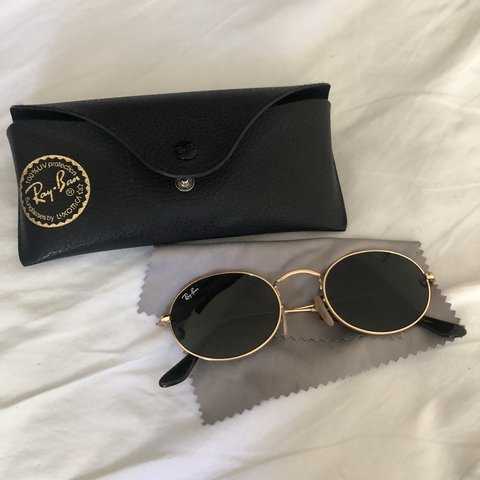 9511df0c15 Round oval shaped Ray Bans. Gold frame and black lens. Worn - Depop