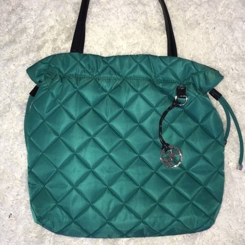 f413bacad1ba @re_new. 7 months ago. Los Angeles, United States. Turquoise Michael Kors  Tote Bag