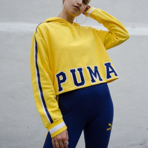 9d9ffca1bed5 Yellow Puma cropped hoodie jumper with navy blue stripes on - Depop