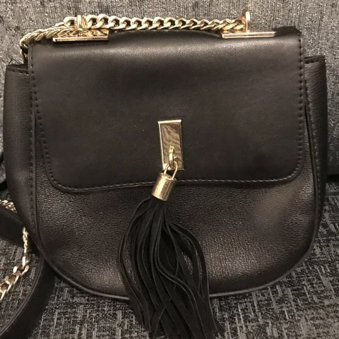f7ea6a734 @tljenkins. 2 months ago. London, United Kingdom. Topshop black faux  leather cross body bag ...