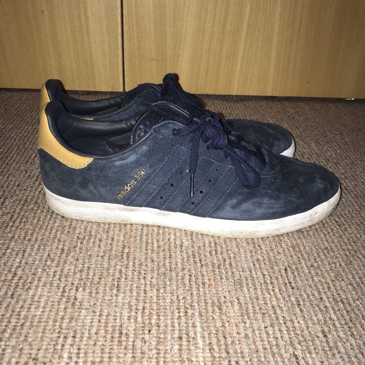1214ac5d3 Adidas Originals 350 trainers in navy blue with gold trim In - Depop