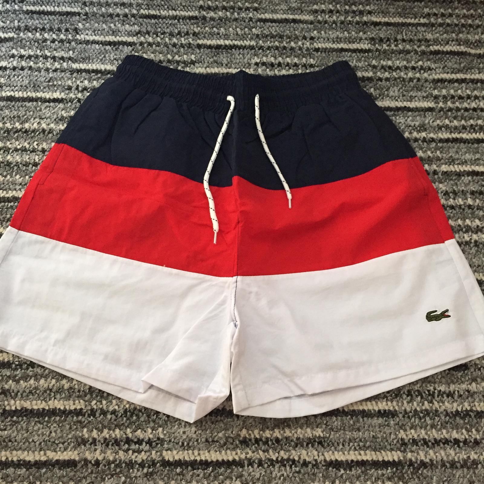 4ad78a89 men's Lacoste live swim shorts navy red & white... - Depop