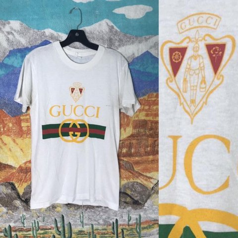 5171370e @psychic_outlaw. 7 months ago. Austin, United States. BOOTLEG Gucci classic  big logo soft and thin white vintage 1980's graphic tee men's women's small  ...