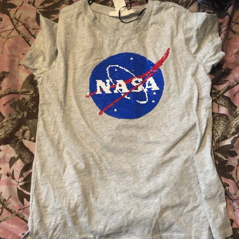 1ff8f53219c @zoeygreen. 21 days ago. Thurmont, United States. A NASA shirt!! Has reversible  sequins!