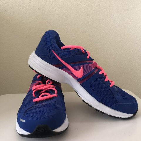 d7b42250b808 Ladies Nike trainers in size 7. Blue with fluorescent pink a - Depop