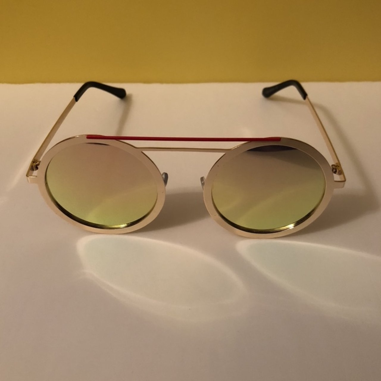 7b90b3188f Round fashion sunglasses Gold metal frame. Pink tinted on - Depop