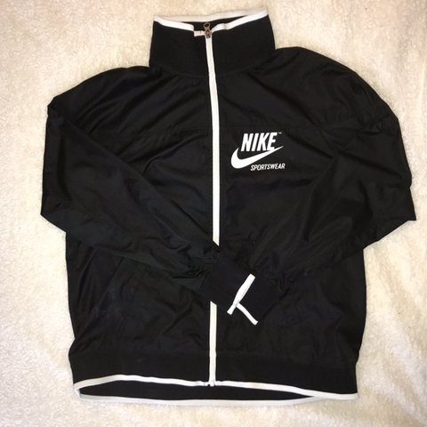 2c5227fc3 @klfollett. 4 months ago. Lockport, United States. Black and white Nike  Sportswear Windbreaker zip up jacket.