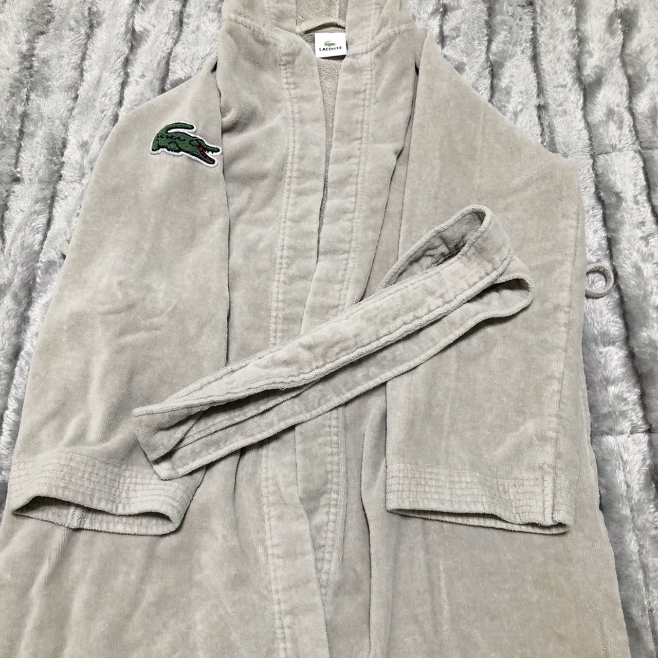 e7f6aa40b3 Gray Lacoste hooded bathrobe  size unknown. Thinking a youth - Depop