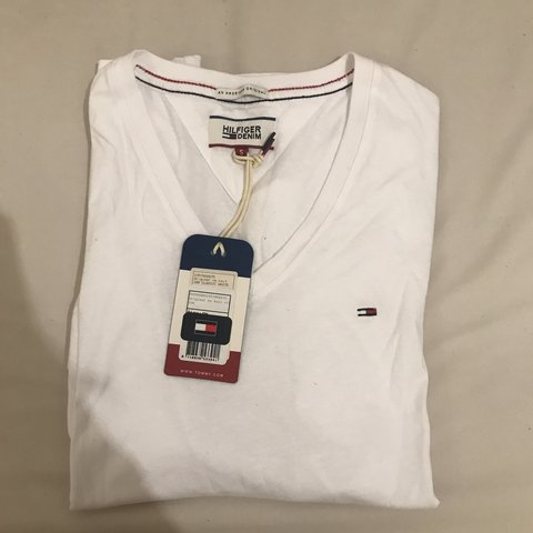 307f4d14 @chaxz. 8 days ago. Leicester, United Kingdom. Tommy Hilfiger v-neck tee- shirt / top. Classic white