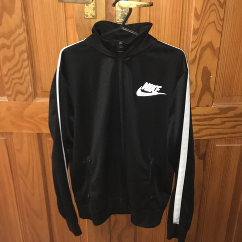611c0bc062 Nike track top jacket black with white stripe on the sleeve - Depop