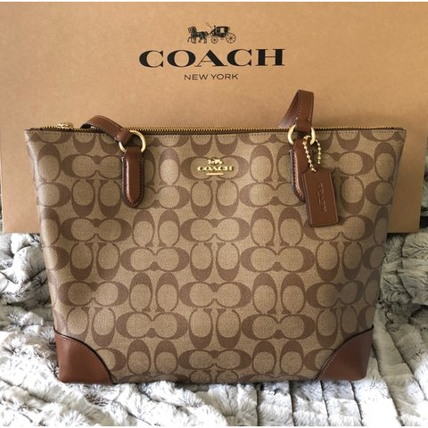 1293c6f38 @riose. 6 days ago. Mount Prospect, United States. Coach Zip Top Tote In Signature  Canvas Khaki / Saddle Brown ...