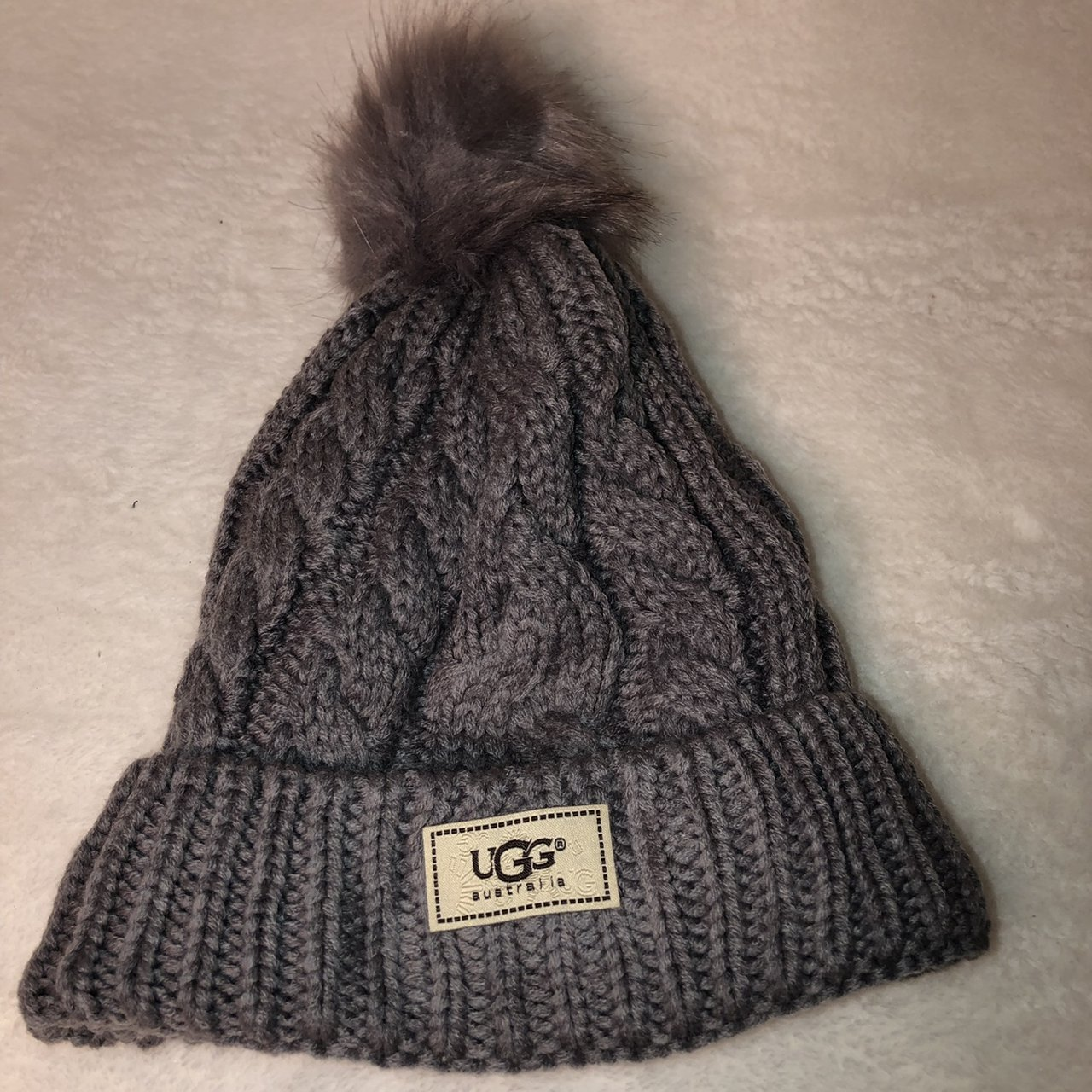 fbd98949668 UGG Cable Knit Pom Beanie Gray in color Brand New - Depop