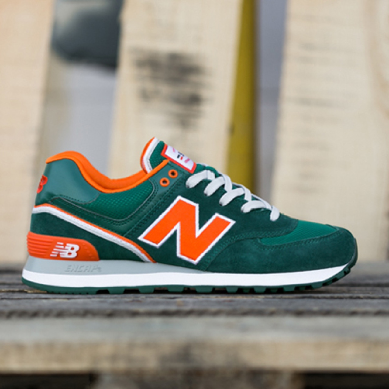 New Balance 574 Green/Orange 'Stadium' trainers in a ...