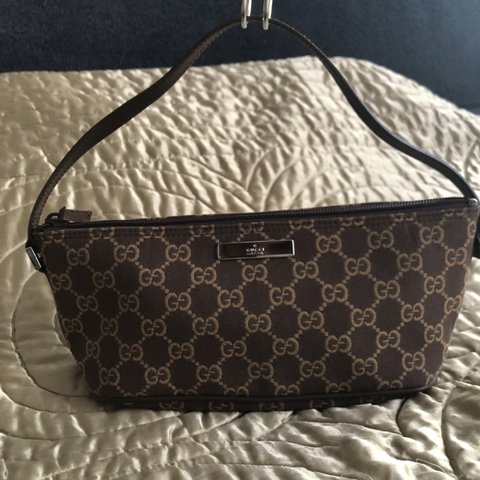 a76a0da0c313 ON HOLD Authentic Gucci baguette bag in brown with iconic GG - Depop