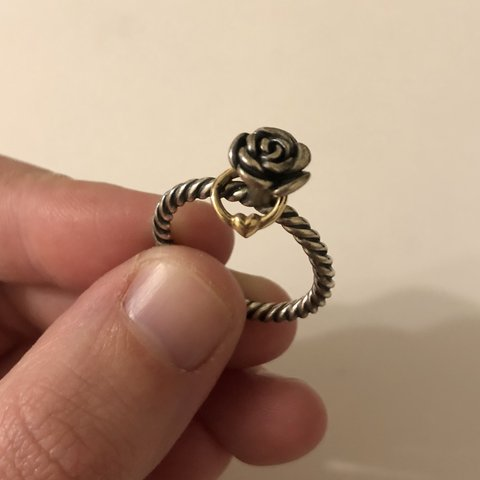 461fbf988 @autumnnix. 5 months ago. Nottingham, United Kingdom. Pandora flower ring  with small gold love heart attachment. Now discontinued. Size 54