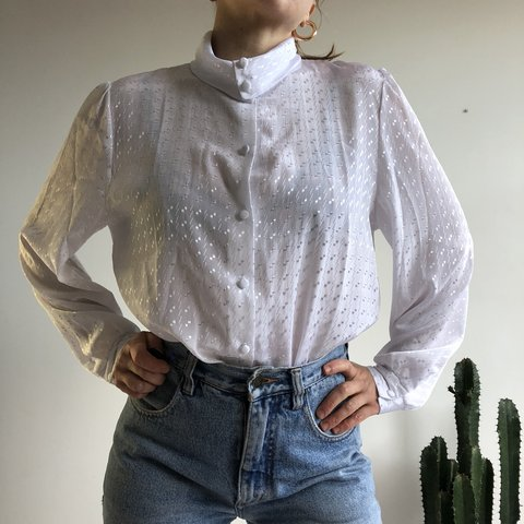 db94c73f @ankaem. last month. London, United Kingdom. Vintage white flowy blouse.