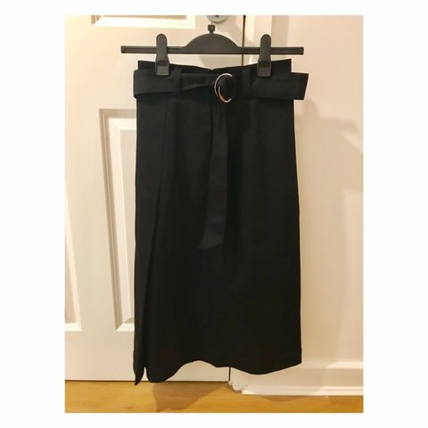 b49b229b9 Midi length high waisted skirt with a circle buckle by And - - Depop