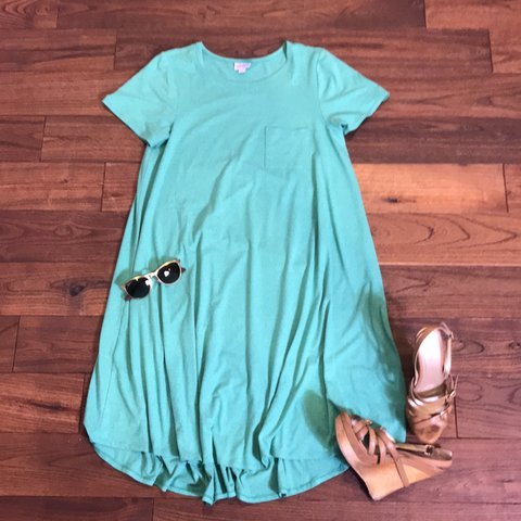ac52e314fe9 Lularoe Carly TShirt Dress Style high low Size medium from - Depop