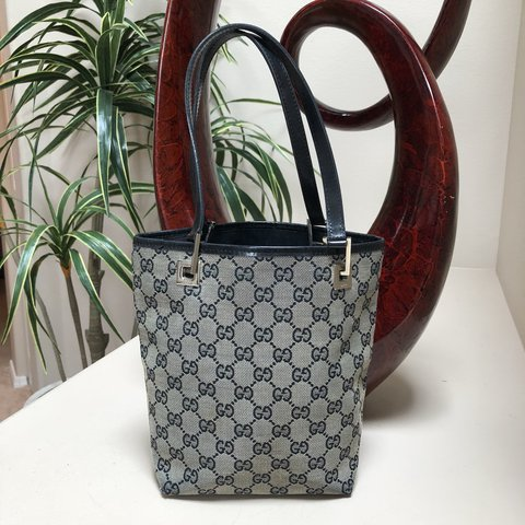 c690700338d45f @illlisted. last year. Auburn, United States. Authentic Gucci monogram tote  bag in gray and black. Classic.