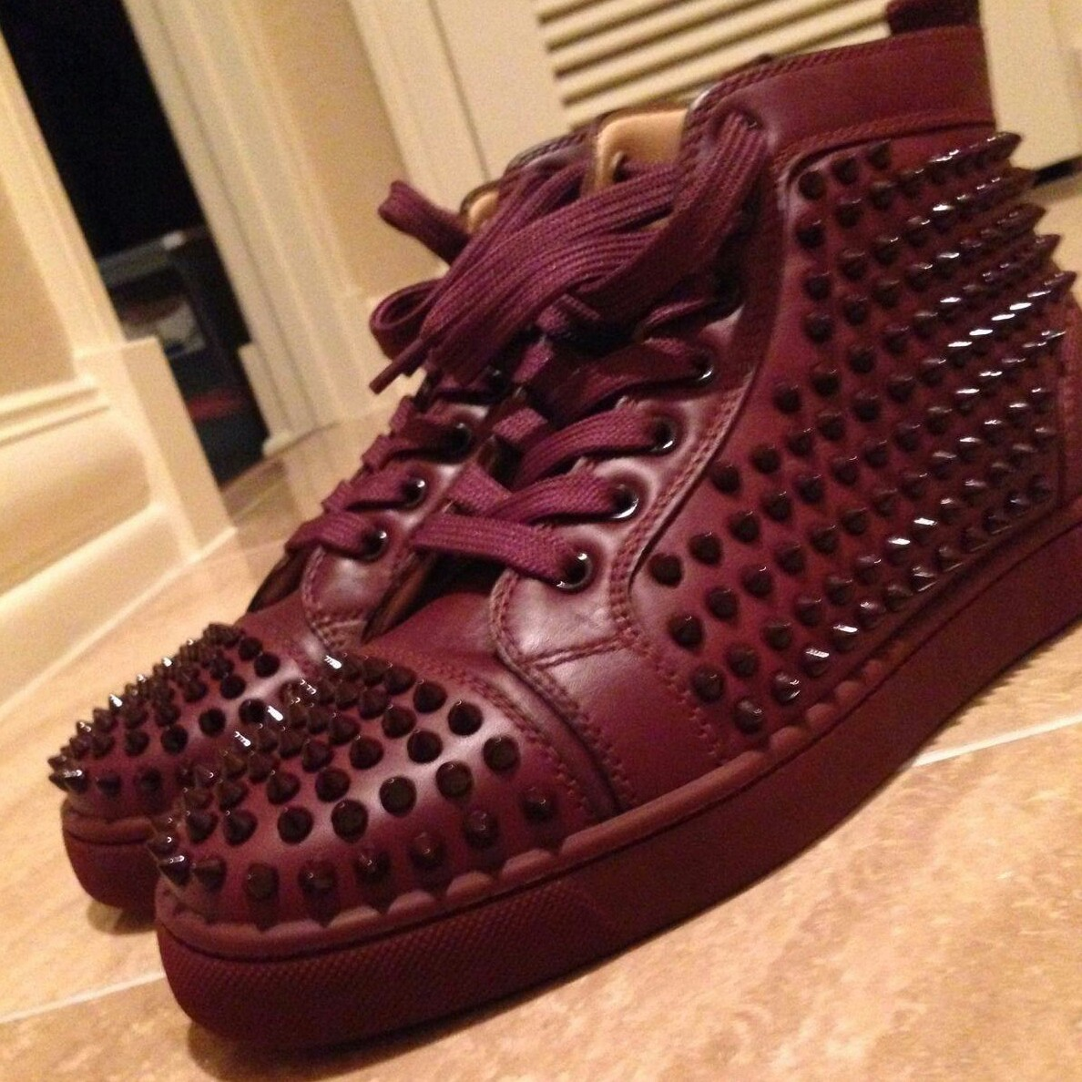 quality design aa170 4ca89 Christian Louboutin Spiked Lace Up Burgundy Sneakers ...