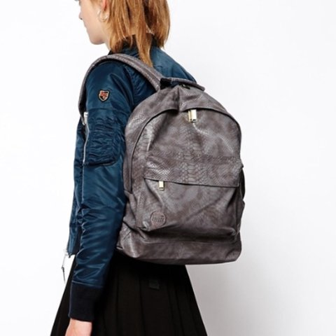 c832a77d402 @chiolo09. last year. Erith, United Kingdom. Grey faux python unisex miPAC  backpack.