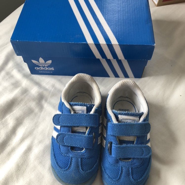Baby boy blue Adidas Dragon trainers. Size 4K comes...