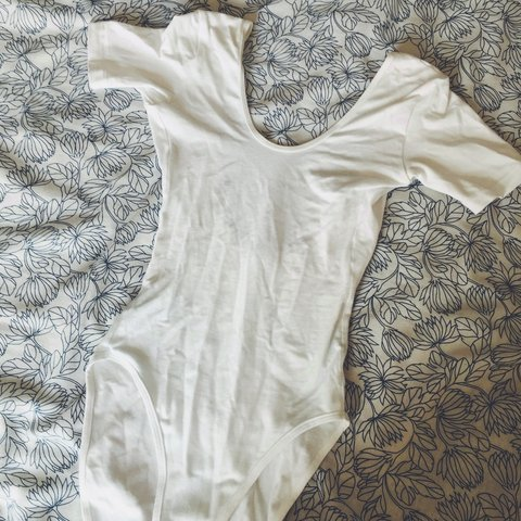 69d79a9ee99 American Apparel White Bodysuit. Great for festivals! Dipped - Depop