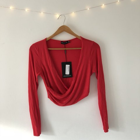 2d70195fef71 @claudie_trott. 9 months ago. Exeter, United Kingdom. 🌟 Red Jersey Wrap  Long Sleeved Crop Top 🌟