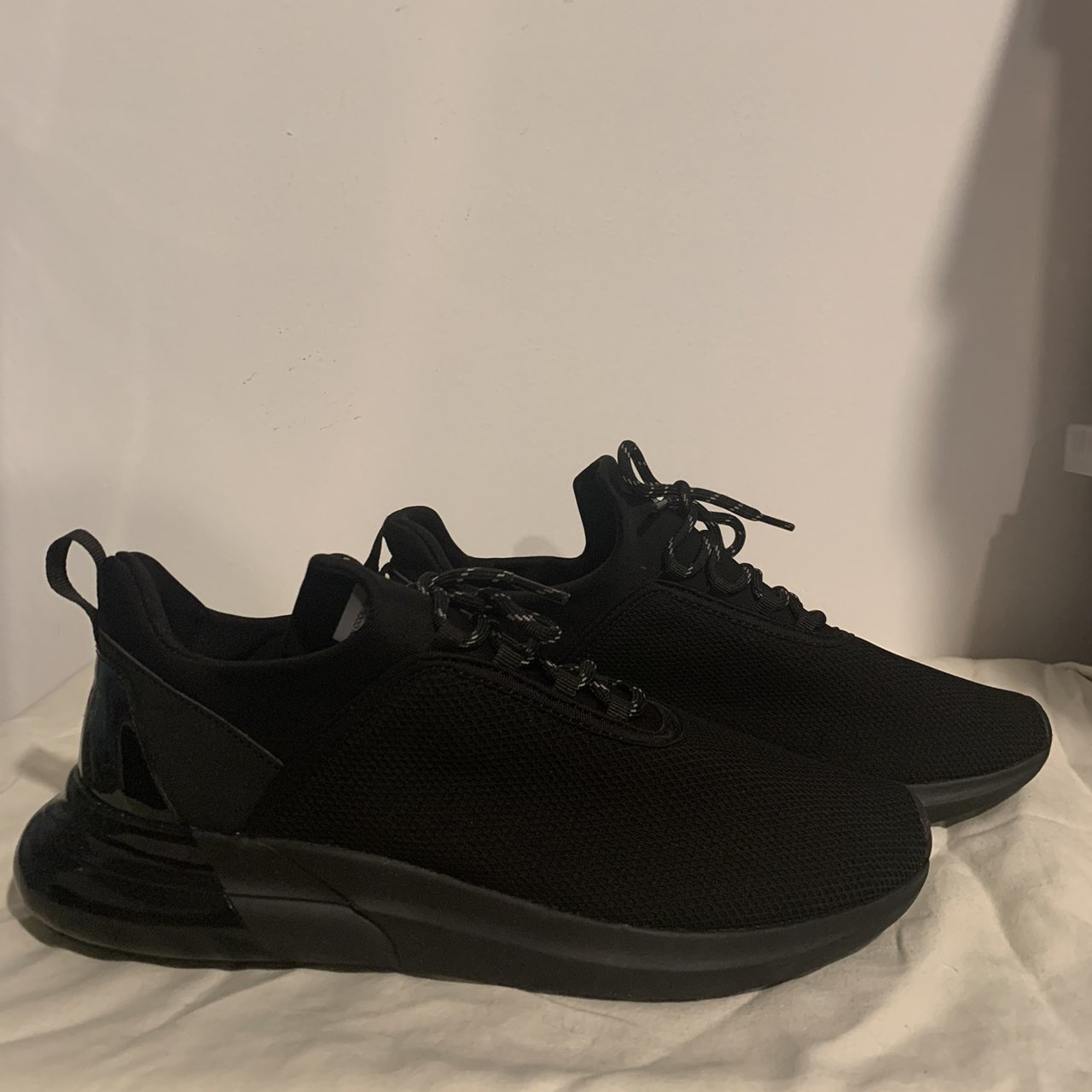 Primark, black trainers with shiny back