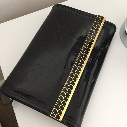 80f0d4ffd Ted baker black patent clutch bag with gold detail and quite - Depop