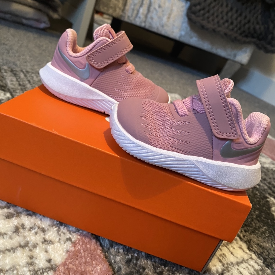 Baby girls Nike trainers in a dusty