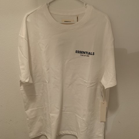 d28eb7cc0 NEW WITH TAGS WHITE FEAR OF GOD FOG ESSENTIALS TEE / LOGO so - Depop