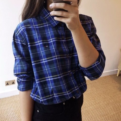 602a0973 @hogtown14. 5 months ago. Winchester, United Kingdom. Tommy Hilfiger  checkered patterned blue oversized shirt. Looks amazing with high waisted  skinny jeans.