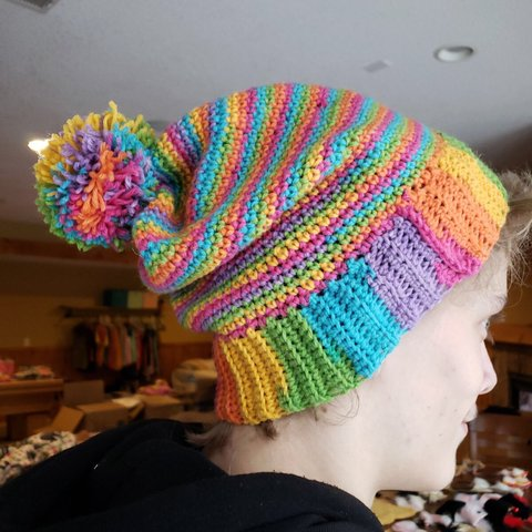 9bb3289d5fb Hand crocheted rainbow slouchy beanie with Pom Pom  beanie - Depop