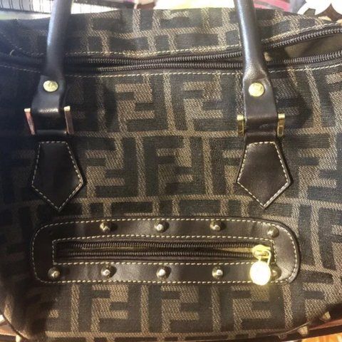 3d2049795f @wellnessorg. 5 months ago. United States. Authentic Fendi brown purse Roma  made in Italy