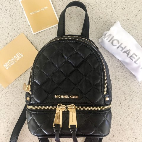 36fdb2e33f04 @sylshamoun. 3 months ago. Clear Island Waters, Australia. Michael Kors  Rhea Extra Small Quilted Backpack Leather Black/Gold