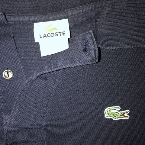 bee49c0ed3a3 Lacoste navy blue polo shirt. Size is a 4 which is a men s a - Depop