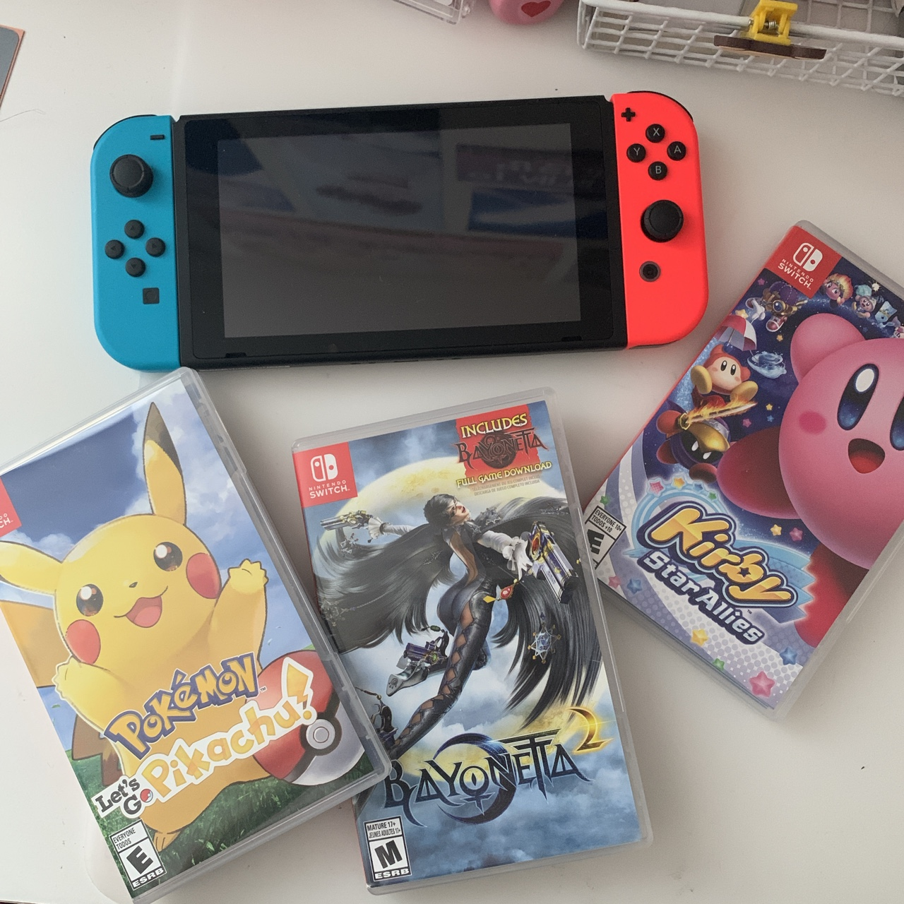 Nintendo Switch with a few games including Lets Go    - Depop