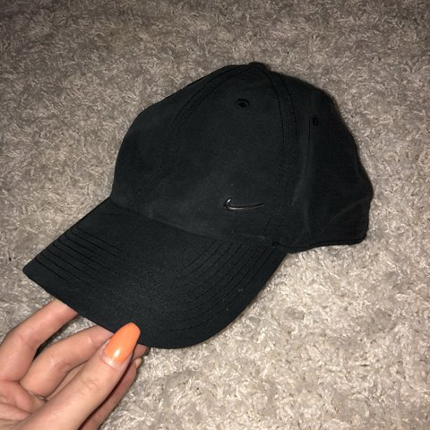 178e34daa4f OPEN TO OFFERS Black nike cap with silver tick on the side. - Depop