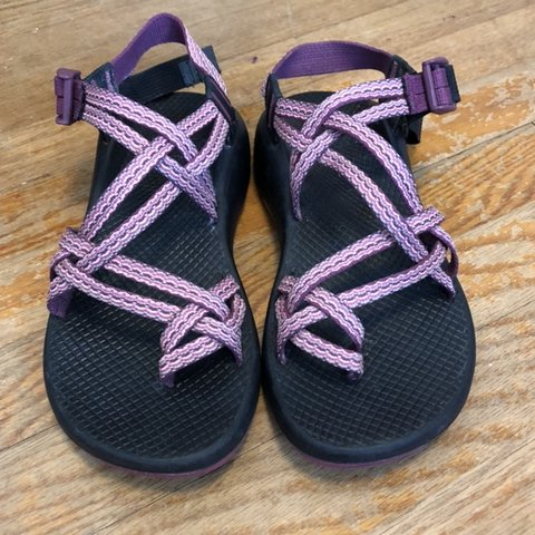 adc523a2636a Two strap pink purple patterned Chacos with black soles in a - Depop