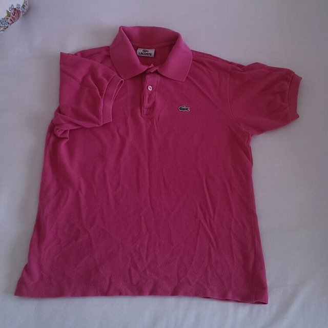 a0bf26159 PINK LACOSTE POLO SHIRT. UK KIDS 14 BUT WILL FIT A SIZE 6 8. - Depop