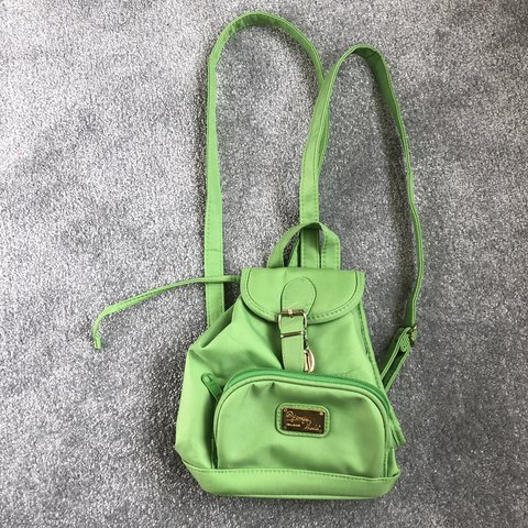 2d4ffa09ff9 Green mini backpack - Depop