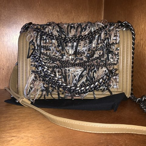 7ad1687bc9cb @candygiirl908. last month. Roselle, United States. This authentic Chanel  Paris-Dallas Boy Flap Bag Enchained ...