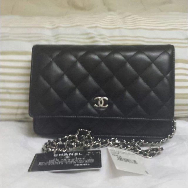 c939b1ce052e @opulenthabits. 5 years ago. Millburn, NJ, USA. Authentic Black Lambskin  Quilted Chanel WOC Wallet on a Chain ...