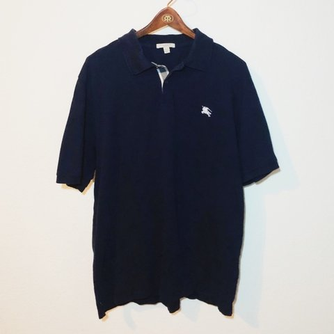 3940ae4f @unparalleledvintage. 12 days ago. Tempe, United States. Mens XL Burberry  London Dark Navy Polo Embroidered Burberry logo