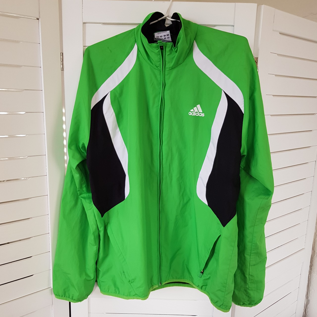 Adidas jacket in bright green with black and white Depop