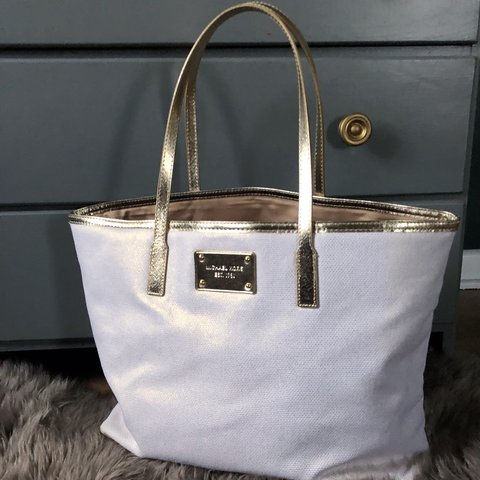 3c9ae4444f51 @alexobey. 7 days ago. New Britain, United States. White iridescent Michael  Kors tote bad with gold trim.